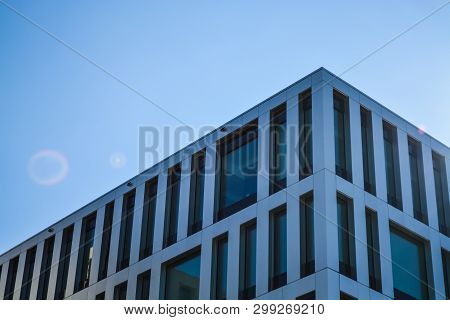 Modern Architecture Of Office Buildings. A Skyscraper From Glass And Metal. Reflections In Windows O