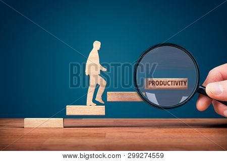 Coach Focused On Motivation To Productivity Improvement. Hand With Loupe And Person Made From Wood A