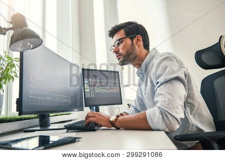 Confident Businessman. Young Bearded Trader In Formal Wear Is Analyzing Trading Charts On Computer S