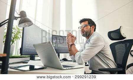 So tired. Side view of exhausted young beard businessman or trader in formal wear and eyeglasses feeling tired after long working day in office. poster