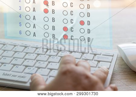 Dry Hand Of Adult Student Using White Keyboard On Table To Do Test Examination With Multiple Choice