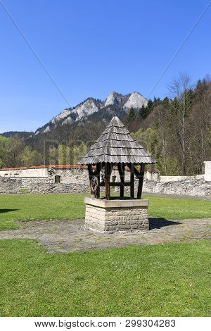 14th Century Red Monastery,wooden Well And View On Three Crowns Massif, Slovakia