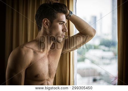 Sexy Young Man Standing Shirtless By Curtains
