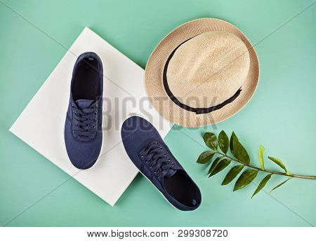 Blue Marine Sneakers Shoes Over Aquamarine Backgroung. Summer Urban Outfit, Vacation, Sea Trip Conce
