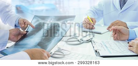 Group Of Doctors Brainstorming Diagnose Treatment Patient At Operating Room Hospital.