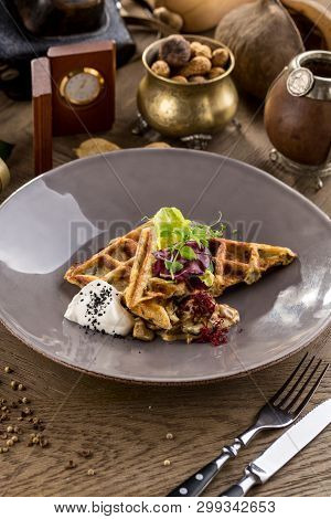 Savory Waffles With Mushroom And Creamy Sauce On Plate On A Wooden Table Side View