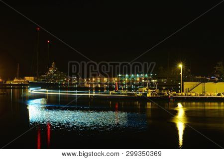 Nigh Landscape; Movement In Harbor , Light And Colors Reflected