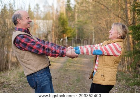 Mature Couple Holding Hands Trusting Each Other.
