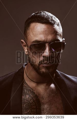 Metrosexual guy. Serious confident masculine glance. Fashion industry. Muscular athletic sexy male with tattoos. Confident and handsome brutal man. Male fashion. Attractive fashionable macho. poster