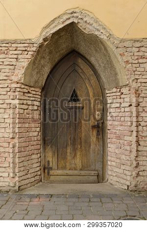 The Door Of The Convent; Repairs Are Needed