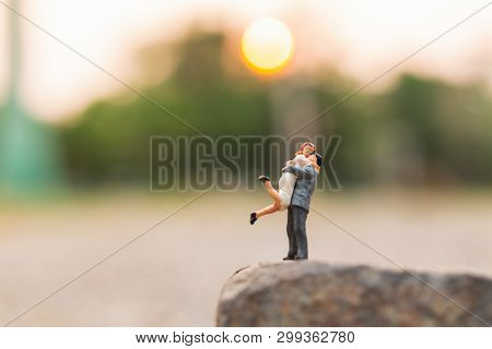 Miniature People : Couple Standing On The Rock Cliff And Copy Space For Text