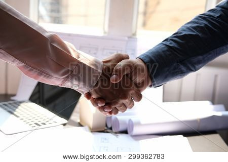 Engineer Handshaking. Architect Shaking Hands For Building Construction Project. Teamwork Cooperatio