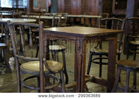 Wooden Chair Table In Cafe Coffee Shop Restaurant. Interior Decoration