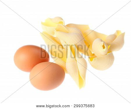 Raw Dry Conchiglioni, Eggs Close Up Isolated On White Background