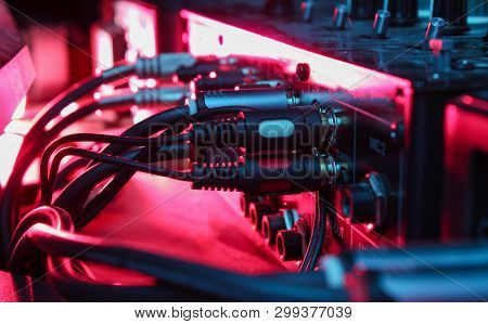 Night Club Concept. Audio Mixer With Wires Close Up. Neon Light
