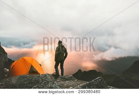 Man Traveling With Tent Camping On Mountain Top Outdoor Adventure Lifestyle  Hiking Active Extreme S