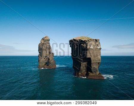 Aerial Picture Of Wild Rock Formations In The Middle Of The Open Atlantic Ocean Next To Mosteiros, I