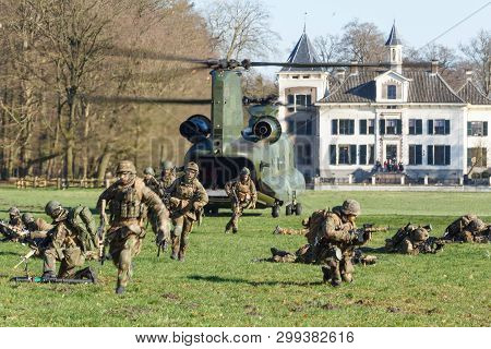 Olst Feb 7 2018: Amry And Air Force Helicopter Exercise. Chinook Landing To Drop Soldiers
