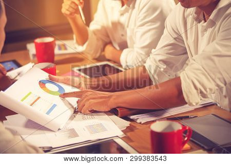 poster of business adviser meeting to analyze and discuss the situation on the financial report in the meeting room.Investment Consultant,Financial Consultant,Financial advisor and accounting concept.vintage color
