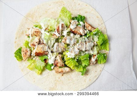 Grilled Chicken Caesar Wrap. Chicken Wrap Sandwich. Top View