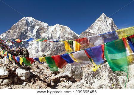 Rows Of Prayer Flags And Mounts Arakam Tse And Tabuche Peak, Sagarmatha National Park, Trek To Evere