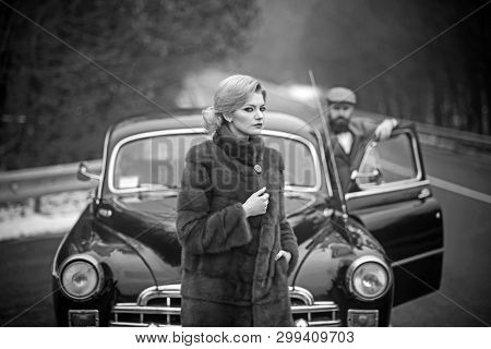 Nostalgia Concept. Nostalgia And Retro Car At Bearded Man And Woman In Coat
