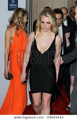 LOS ANGELES - FEB 11:  Tamara Braun getting out of the way as Britney Spears arrives at the Pre-Grammy Party hosted by Clive Davis at the Beverly Hilton Hotel on February 11, 2012 in Beverly Hills, CA