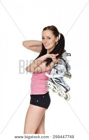 Young  sporty woman with rollerskates on a white background.
