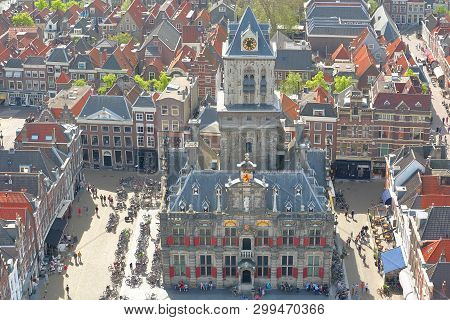 Aerial View Of The Main Square (markt) With The Town Hall (stadhuis) Surrounded By Traditional And C