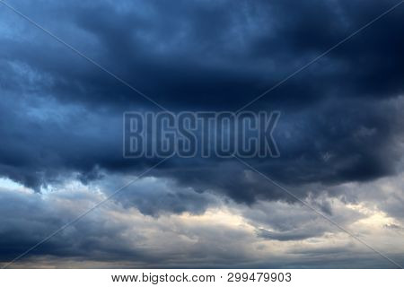 Storm Sky Covered With Dark Cumulus Clouds Before The Rain. Dark Cloudy Sky, Overcast Day, Beautiful
