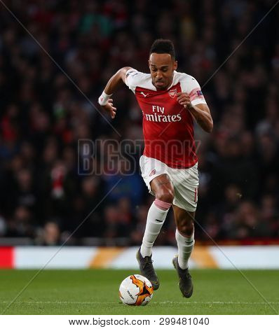 LONDON, ENGLAND - MAY 02 2019: Pierre-Emerick Aubameyang of Arsenal runs with the ball during the Europa League semi final leg one match between Arsenal and Valencia.