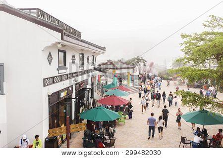 Nongping, Hongkong - 29 March 2019  View Of People Enjoy Shopping And Sight Seeing At Nong Ping Vill