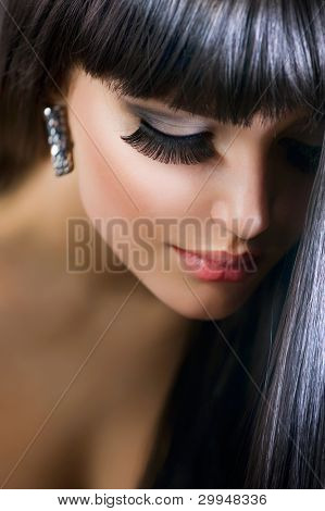 Beautiful Brunette Girl. Healthy Long Hair. Holiday Makeup