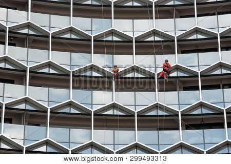 Industrial Mountaineering Workers Staff  Wash Windows Of A High-rise Building, Man Cleaning Cleaning
