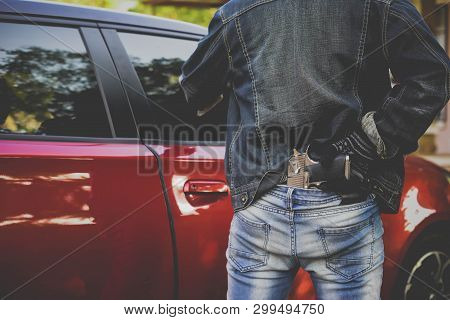 Gangster With A Gun Trying To Rob Car.