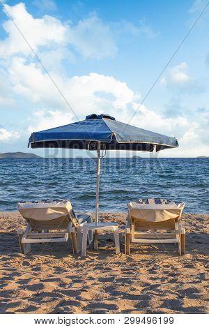 Sunshade On Sandy Beach Sea With Blue Sky