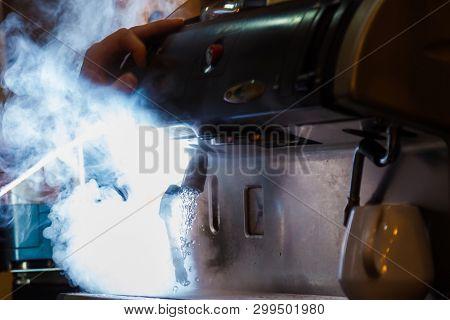 coffee machine with white smoke
