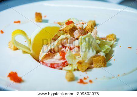 fresh seafood salad with crackers and salmon caviar