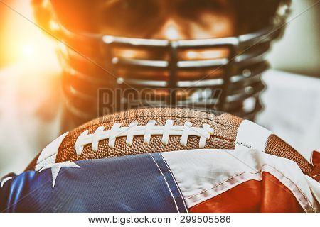 American Football Concept. The Ball For The American Football Lies On The Flag Of America Against Th