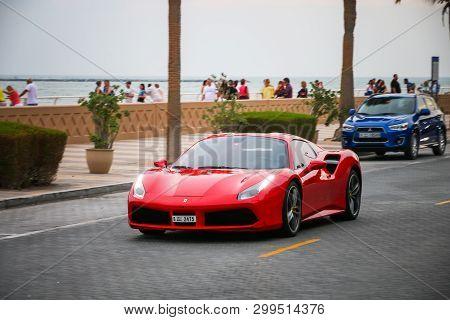 Dubai, Uae - November 17, 2018: Red Luxury Sportscar Ferrari 488 In The City Street.