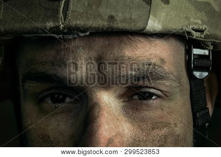 Eyes Full Of Pain And Confusion. Close Up Portrait Of Young Male Soldier. Man In Military Uniform On