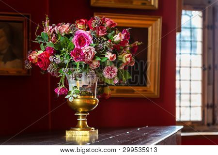 Vase With A Beautiful Fresh Bouquet Of Flowers In The Interior Of An Ancient Palace. Bouquet Of Flow