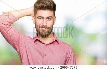 Young handsome business casual man confuse and wonder about question. Uncertain with doubt, thinking with hand on head. Pensive concept.