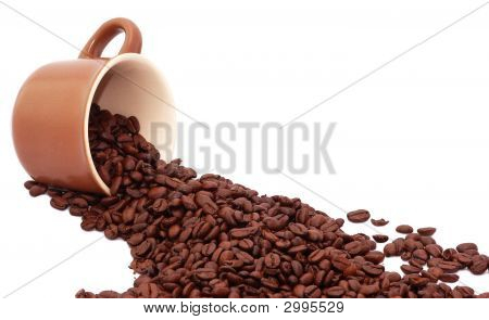 Coffee Cup And Roasted Coffee Beans Isolated On White