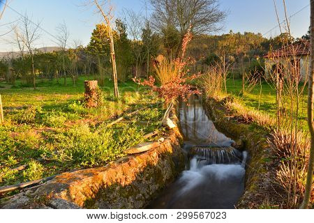 Winter; Running Water In The Canal At Sunset