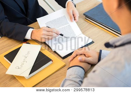 businessman hand sending a resignation letter to executive boss dismissed worker quit out from company, Change job, unemployment, resign concept. poster
