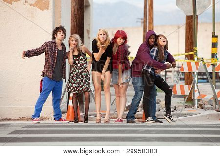 A group of young fun-loving punky looking teens pose for a group photo. poster
