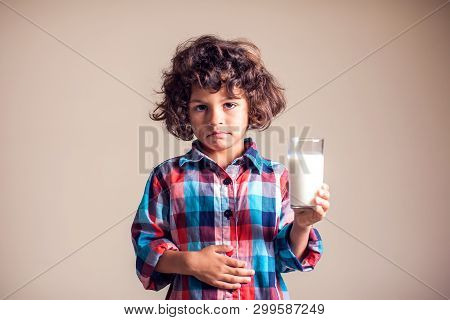 Kid Boy With Stomach Pain Holding A Glass Of Milk. Dairy Intolerant Person. Children, Health Care Co