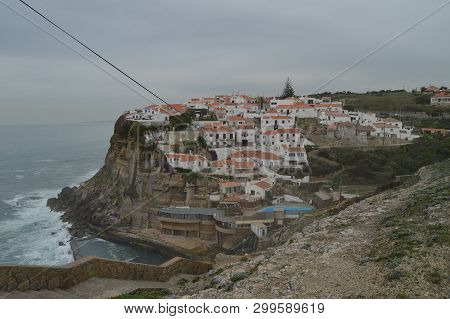 Views Of The Houses Perfectly Located On A Cliff And With A Natural Pool On Their Background In Cola