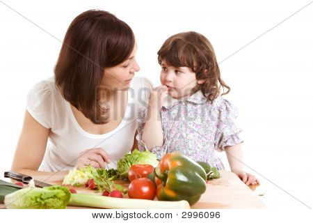 mother and daughter cooking salad at the kitchen poster